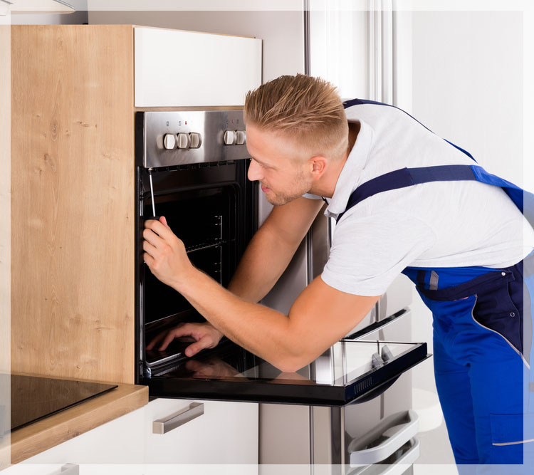 appliance technician in Adelaide repairing an oven
